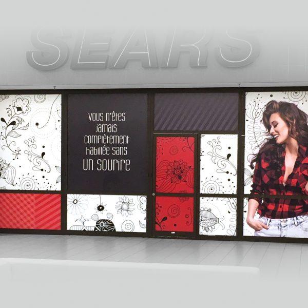 impression et installation de lettrage de vitrine pour un centre d'achat