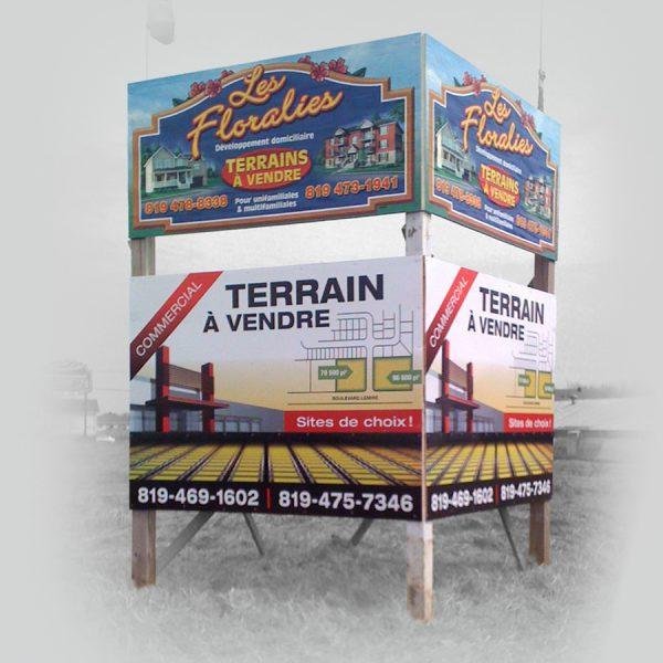 réalisation de panneaux publicitaire à vendre sur une structure extérieure en bois